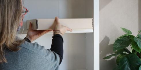woman placing box on shelf