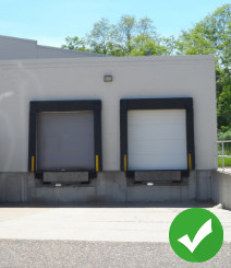 Two loading docks with green check mark