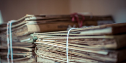 Folders and documents bundled with white string