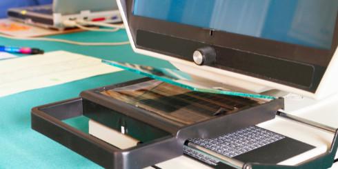 microfiche machine on desk